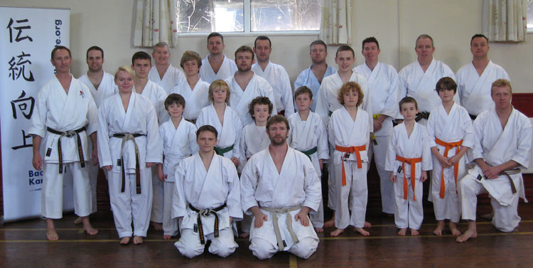 Sensei Matt Price lines up with the class for a photo